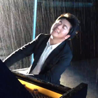 Lang Lang playing piano in the rain