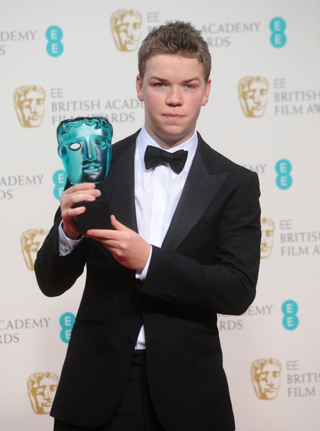 Will Poulter in a black tuxedo
