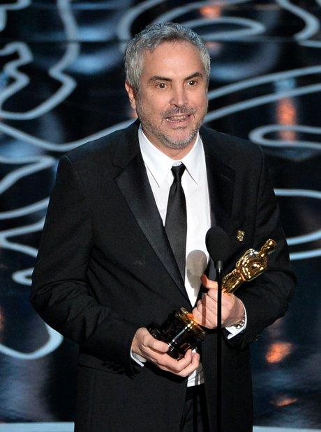 Alfonso Cuaron at the Oscars 2014 winner